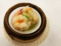 Chinese food in China town, steam prawn in chilli on bamboo basket, dim sum bamboo tray in the local traditional Chinese restauran. T with blur background table Stock Photography
