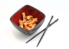 Chinese food with chopsticks and fried wonton strips Royalty Free Stock Photography