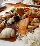 Chinese food close up. Soy sauce with vegetables (carrots, bamboo, paprika, mushrooms)  and rice Stock Images