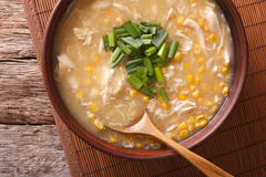 Chinese food: corn soup with chicken and onions close-up. horizo Stock Image