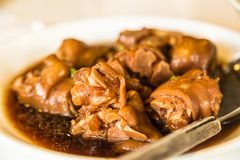 Chinese food delicacy Stewed Pig`s trotter closeup view. Chinese food delicacy Stewed Pig`s trotter closeup royalty free stock photography