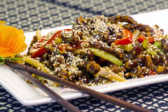 Chinese food detail. Chinese food plate of sesame garnished lamb with vegetables Royalty Free Stock Photos