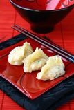 Chinese food - dim sum. On the black plate with chopsticks stock photography