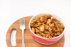 Chinese food in a European way with a fork on a wooden board Royalty Free Stock Photography