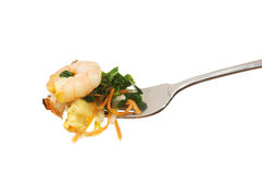 Chinese food on a fork. Isolated against white Stock Photo