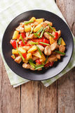 Chinese food: fried chicken with pineapple in sweet and sour sau Stock Images