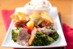 Chinese food with fried rice, beef, chicken and fresh vege Stock Images