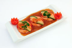 Chinese food - Gourmet broiled king tiger prawns on white. Chinese food, gourmet tiger king prawns served with a vegetables and tomato garnish with copy space Royalty Free Stock Photo