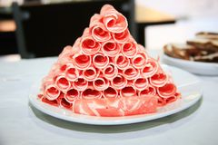 Chinese food hot pot - food materials. Hot pot food: frozen mutton rolls stock images