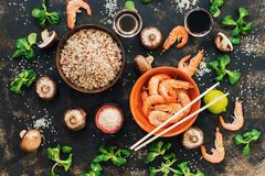 Chinese food, ingredients for cooking. Rice shrimp and mushrooms. The view from the top. Chinese food, ingredients for cooking. Rice shrimp and mushrooms. The Royalty Free Stock Images
