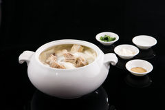Chinese food:mutton stewing with white turnip. Photo in studio with black background Stock Photos