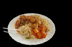 Chinese food noodle and chilli chicken gravy on a plate with black background with space for text.  stock images