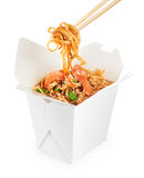 Chinese food. Noodles with shrimp isolated on white background. Royalty Free Stock Image