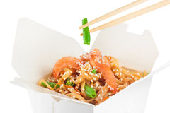 Chinese food. Noodles with shrimp  on white background. Royalty Free Stock Photography