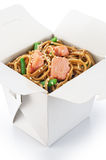 Chinese food. Noodles with vegetables and salmon isolated on whi Stock Image