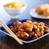 Chinese food - orange chicken on blue plate Royalty Free Stock Photos