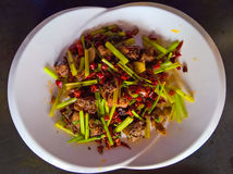 Chinese food. This is a picture of a classic Chinese dish called Spicy Chicken or la zi ji. It is chicken pieces on the bone fried with spicy peppers and celery Royalty Free Stock Photos