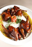 Chinese food, pigeon. On the dish Royalty Free Stock Image