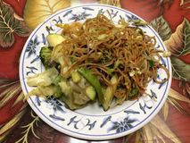 Chinese Food on Plate in Restaurant. Chinese Food (Lo Mein Noodles and Vegetables) on Plate in All You Can Eat Chinese Buffet Restaurant in Hilo, Big Island Royalty Free Stock Photography
