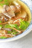 Chinese food, pork liver soup. Chinese food. pork liver soup with carrot, chinese cabbage, green onion, needle mushroom and fungus Stock Photos