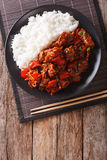 Chinese food: pork in sweet and sour sauce with rice close-up. V Royalty Free Stock Image