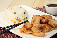 Chinese food: pork in sweet and sour sauce with rice Stock Photography