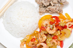 Chinese food - rice, chicken and vegetables with shrimp, closeup Royalty Free Stock Image