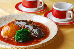 Chinese food--sea cucumber and rice Royalty Free Stock Photography