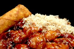 Chinese Food - Sesame Chicken. Sesame chicken, fried rice, and egg roll Royalty Free Stock Photography