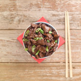 Chinese food Soy sauce cooked beef with star anise. Concept of Chinese food. Beef cooked in soy sauce with spring onions and star anise served in a china bowl Stock Images