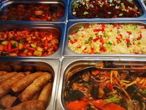 Chinese food in stainless steel casseroles