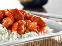 Chinese food - sweet and sour chicken on rice. Closeup photo of Chinese sweet and sour chicken on rice shot with selective focus Stock Images