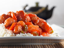 Chinese food - sweet and sour chicken on rice. Closeup photo of Chinese sweet and sour chicken on rice shot with selective focus Royalty Free Stock Photos