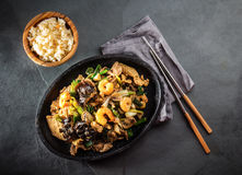 Chinese food. Te pam sao. Pan of fried different meat, shrimps shiitake mushroom Royalty Free Stock Photos