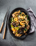 Chinese food. Te pam sao. Pan of fried different meat, shrimps shiitake mushroom Stock Photography