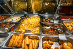 Chinese food under heat lamp Royalty Free Stock Photos