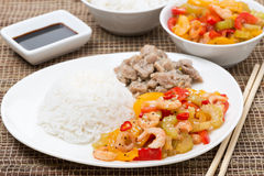 Chinese food - white rice, chicken and vegetables with shrimp Stock Photo