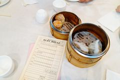 Chinese food in wicker baskets in a Dim Sum restaurant stock image