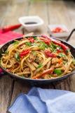 Chinese food on wok Stock Image