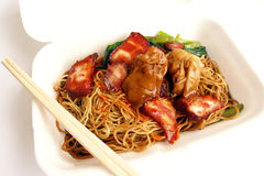 Chinese food, wonton noodles takeaway. Takeaway Chinese food in white styrofoam container. Wan ton (or wonton) noodles with sliced broiled pork, meat and shrimp royalty free stock images
