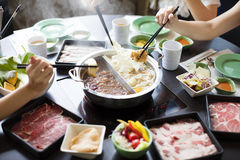 Chinese foods Double flavor hot pot. On the table Royalty Free Stock Photos