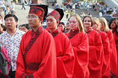 The Chinese and foreign students with a blessing of hanfu gathered in the clock tower at the ceremony Stock Photo