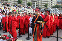 The Chinese and foreign students with a blessing of hanfu gathered in the clock tower at the ceremony Royalty Free Stock Photo