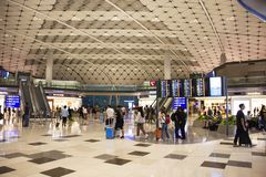 Chinese people and foreigner travelers walking in terminal 2 of Hong Kong International Airport stock photos