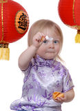 Chinese Fortune Cookie. Cute toddler opening Chinese Fortune cookie for the new year royalty free stock photo