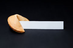 Chinese fortune cookie. On black background royalty free stock images