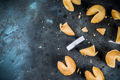 Chinese fortune cookie. With prediction on dark blue concrete background copy space stock images