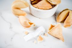 Chinese fortune cookie. With prediction on white marble background copy space stock photo