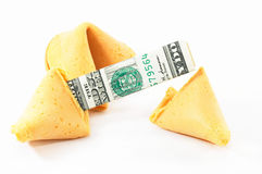Chinese Fortune Cookie open wi. Th money, cash neatly folded inside the snack, on white background Royalty Free Stock Photography