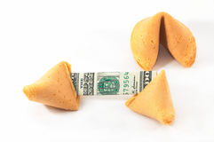Chinese Fortune Cookie open wi. Th money, cash neatly folded inside the snack, on white background. Great luck Royalty Free Stock Images